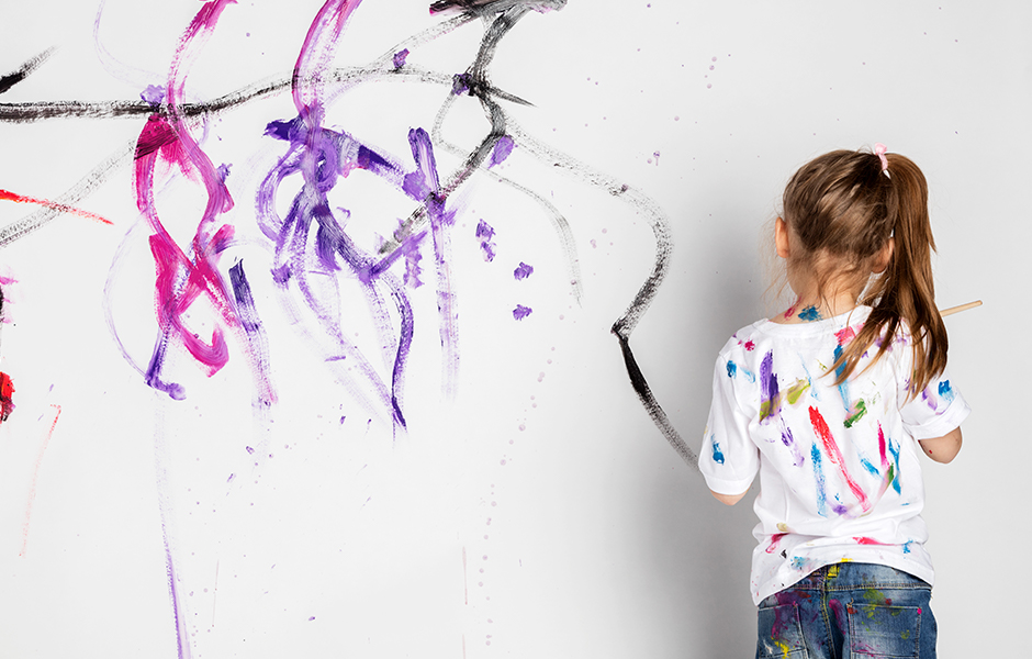 Kid Painting on White Wall