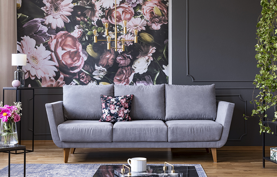 Living room with large scale floral wallpaper