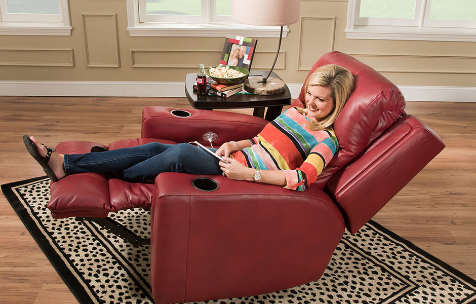 Traditional recliner in reclined position with seat back and footrest up.