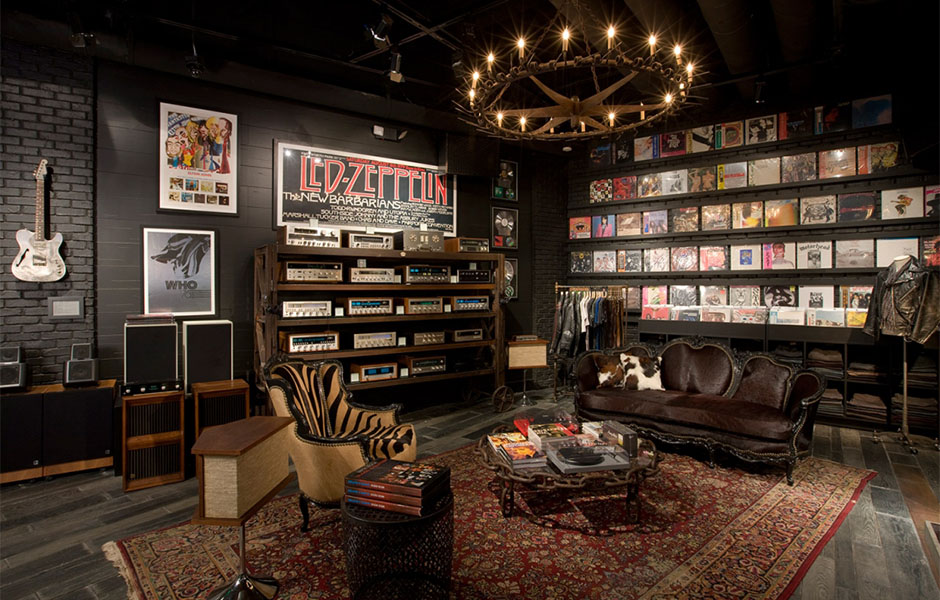 Best man cave for the music lover features rock and roll albums and state of the art musical equipment.