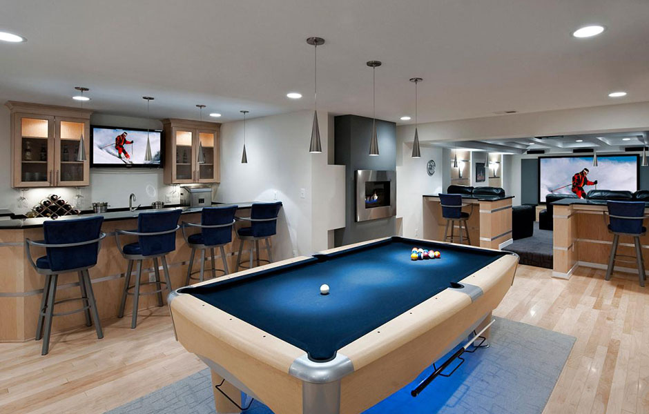 Man cave with kitchen and ample seating, suitable for entertaining.